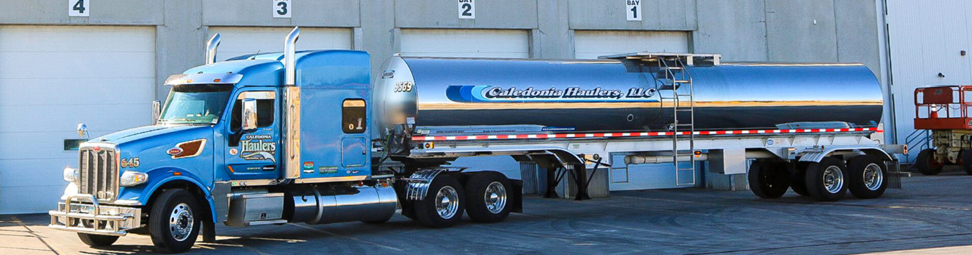 Caledonia Haulers Truck Driving Through the Mountains